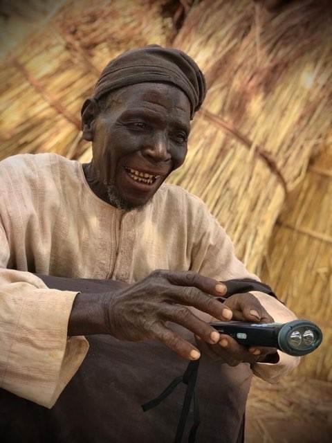Nigerian man listening to Hausa audio Bible